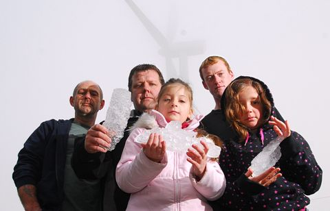 Pictured, from left, are Peter Randall, Tyson Clark and Andrew Randall with Sophia Nesbitt (10) and Tia Clark (10) with some of the blocks of ice which have fallen off the nearby wind turbine in the McCains factory.