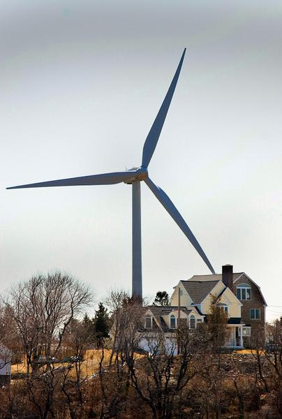 One of Hull's two land wind turbines is on a former landfill, towering over Orleans Street. GREG DERR/The Patriot Ledger