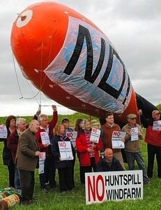 Protesters flew a blimp to demonstrate the height of proposed turbines at Huntspill