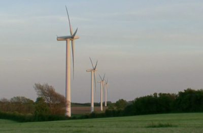 "The 11 wind turbines on Samsø are considerably smaller than the 112 turbines encircling Ocotillo (below) – image taken from the video ""Island in Denmark produces more energy than it consumes."""