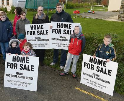 Locals from Irremore with 'Home for sale' posters.