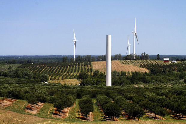 """A """"sprout"""", a wind turbine without a generator, stands among three completed wind turbines in the Consumers Energy Lake Winds' Energy Farm in Riverton Township in this 2012 file photo. (MLive file)"""