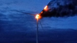Smoke and flames pour from a wind turbine near Westboro Thursday evening.    Photo courtesy of Mark Manchester
