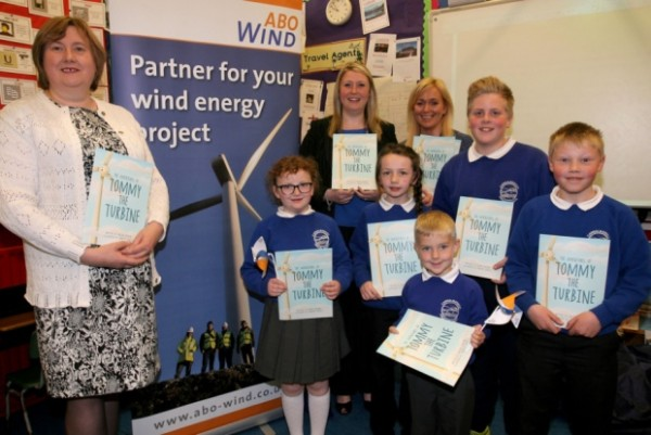 """Pauline Davidson, author of the book """"Tommy the Turbine"""" is pictured presenting copies of her book to pupils from Carnalbanagh PS. Included is Ald. Maureen Morrow and Tamzin Frazer (ABI NI Limited). INBT22-206AC"""