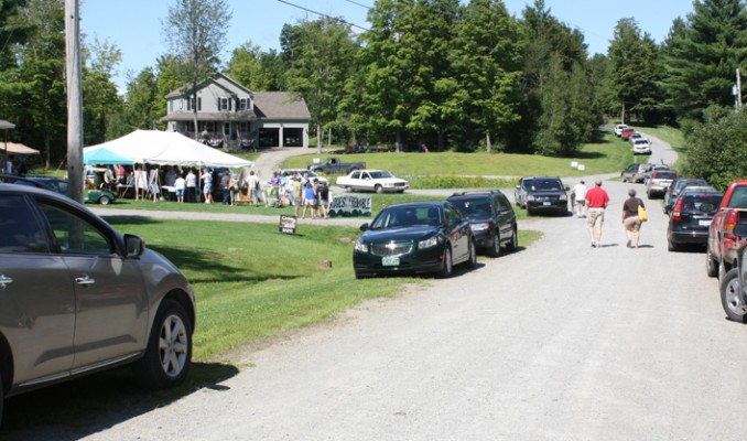 Cars parked along the length of Rocky Ridge Road and a steady stream of people come in and out to hear from the various speakers at the wind fair Saturday. Matthew Preedom, photo.