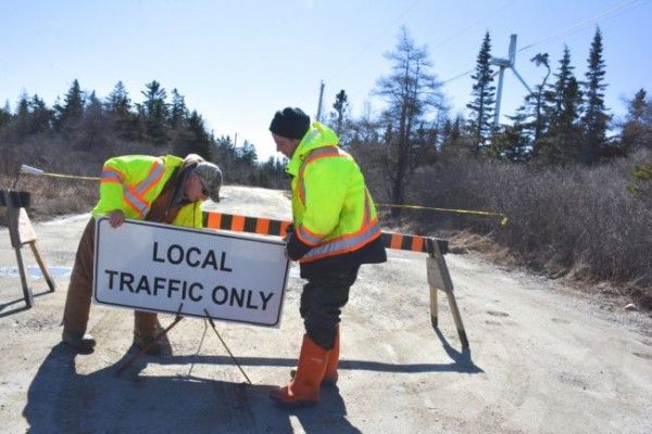Mackenzie Security guards Blair Poole and Craig Spencer set up barricades on a section of the road leading to the wind farm in Pubnico Point, following damage of one of the turbines. TINA COMEAU PHOTO