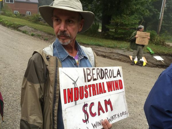 More than two dozen protesters came out from around Vermont and New England to voice their opposition to the project. Mike Fairneny lives near a 19-turbine wind project in Massachusetts.   Credit Howard Weiss-Tisman / VPR